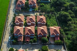 Red roofs in residential area housing, view from the air